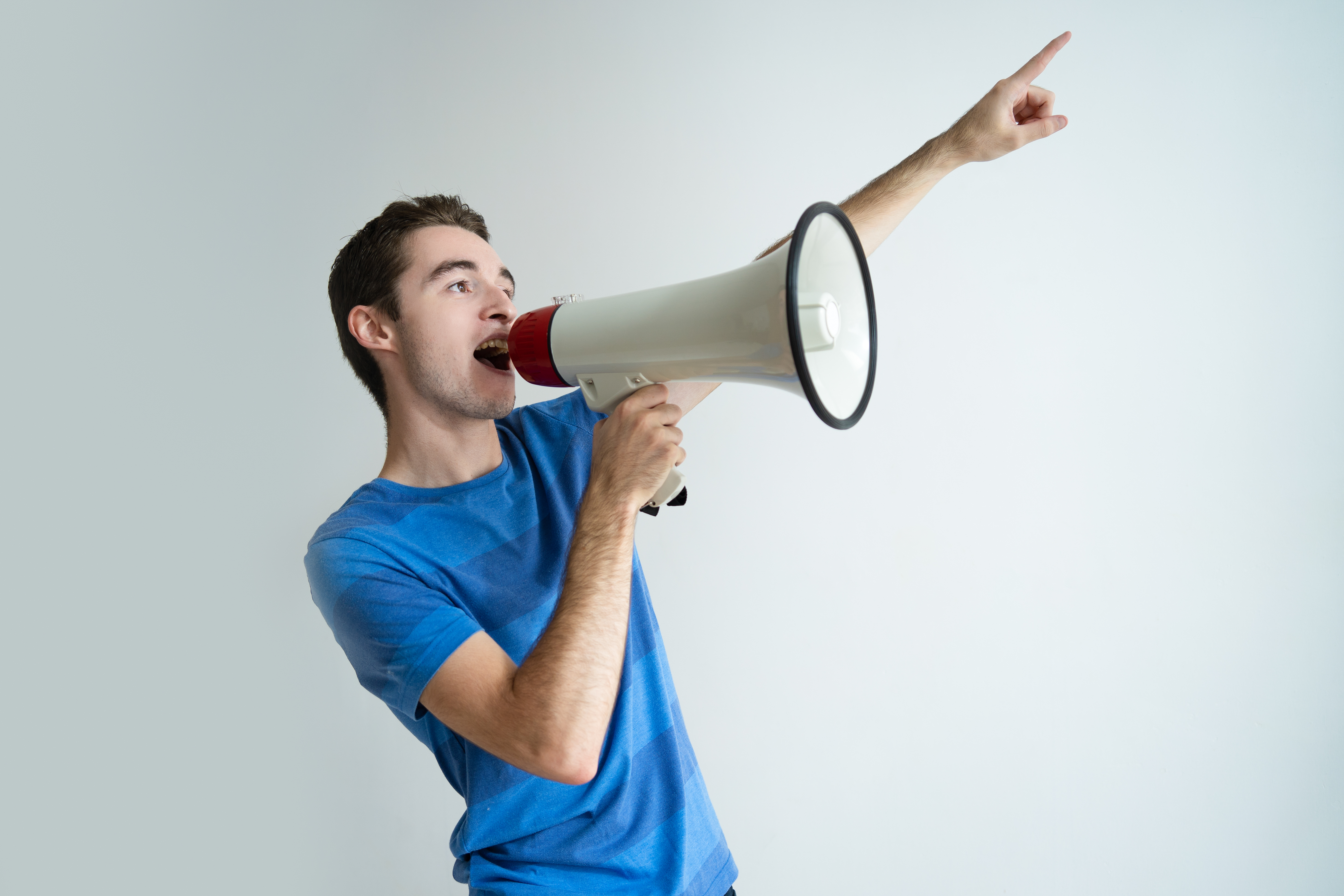 A man speaking into a megaphone