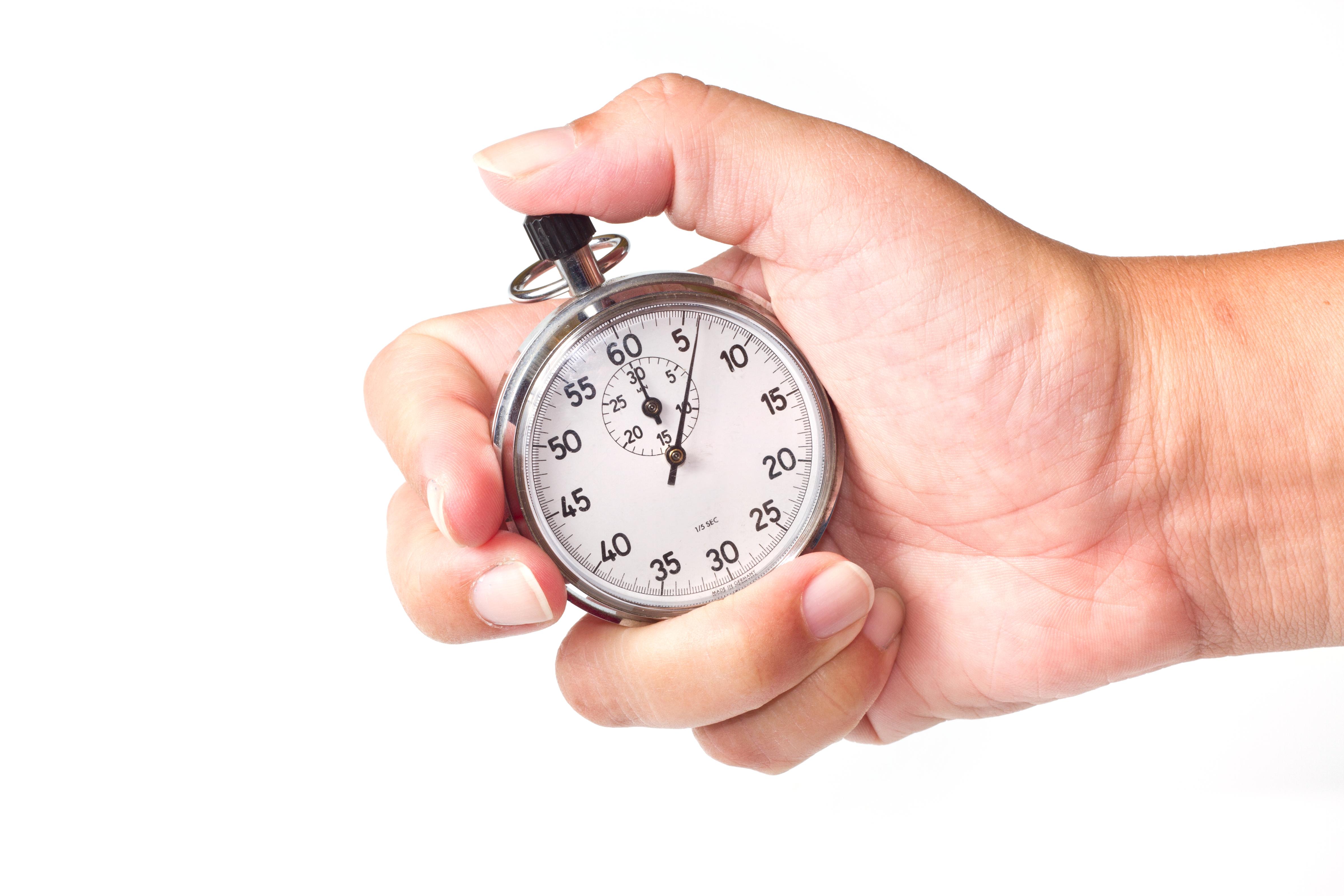 A man holding a stopwatch