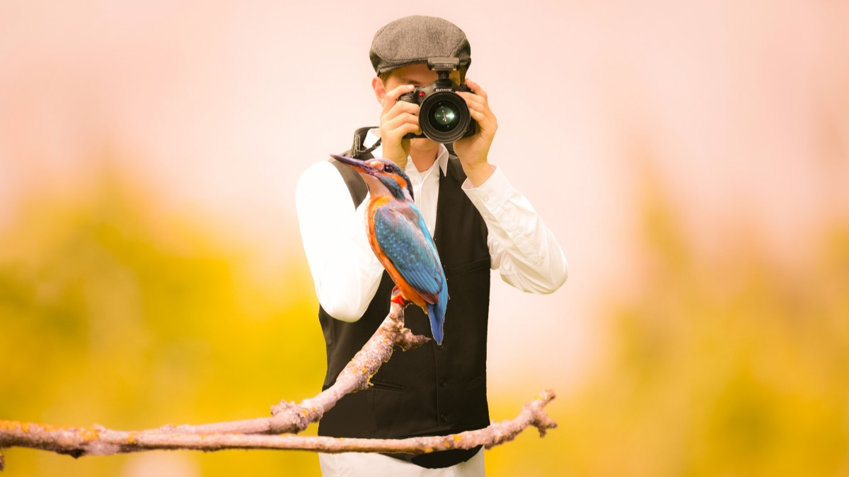 Man taking picture of a bird for Simple App Ideas