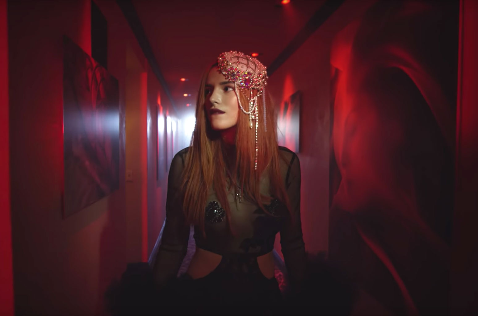 Do Not Disturb: Steve Aoki and Bella Thorne Channel American Horror Story in New Video