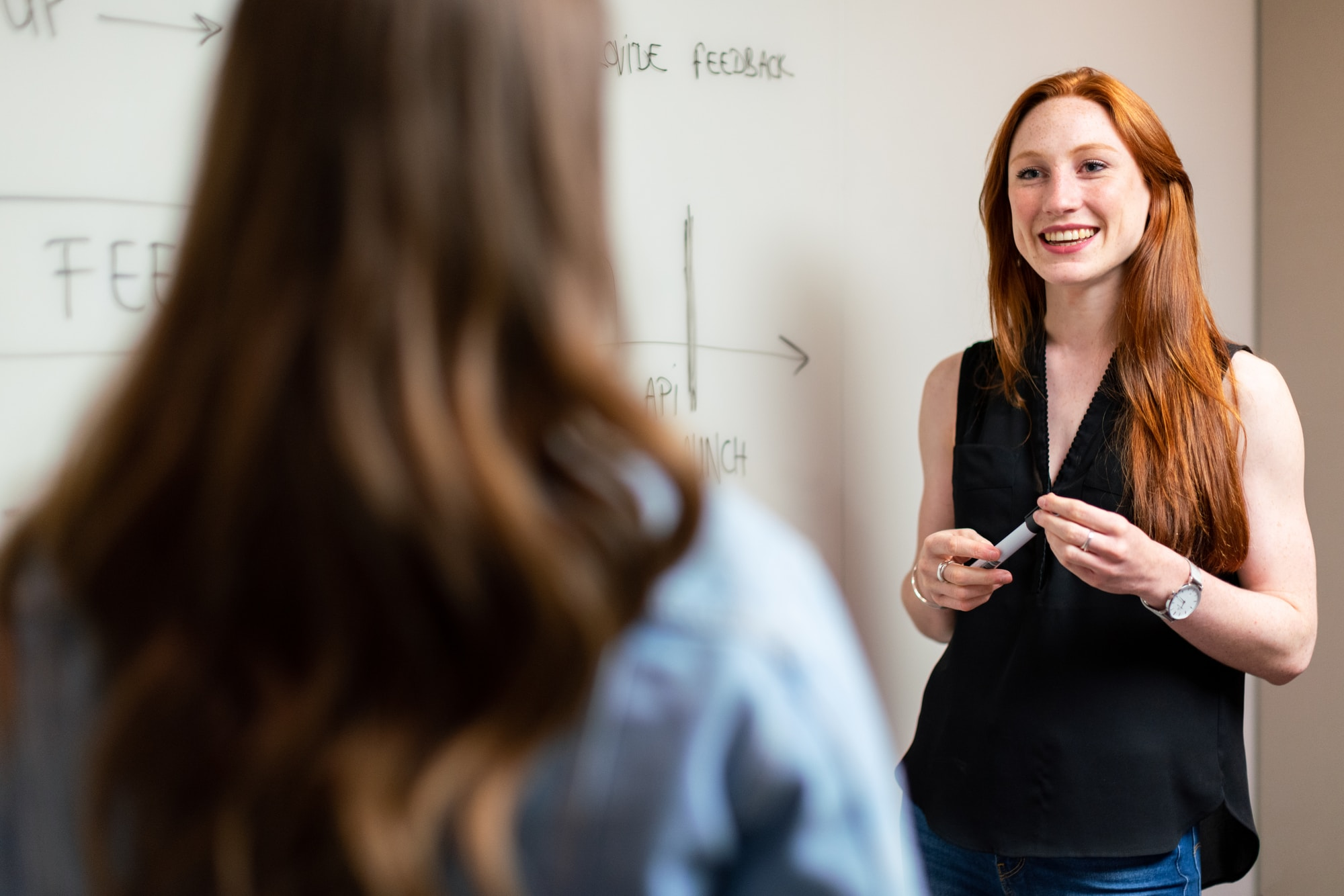 Female software engineer in meeting with colleague